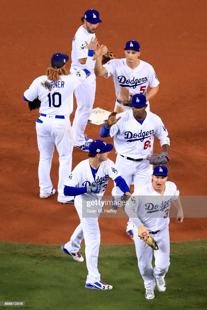 The Los Angeles Dodgers celebrate after defeating the Houston Astros 3-1 in game six of the 2017 World Series at Dodger Stadium on October 31, 2017 in Los Angeles, California.