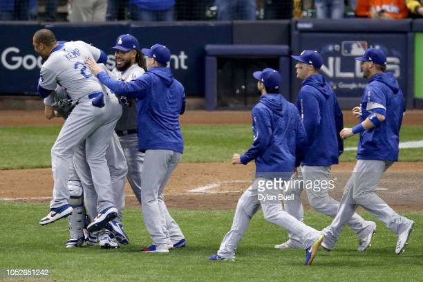 The Los Angeles Dodgers celebrate after defeating the Milwaukee Brewers in Game Seven to win the National League Championship Series at Miller Park...
