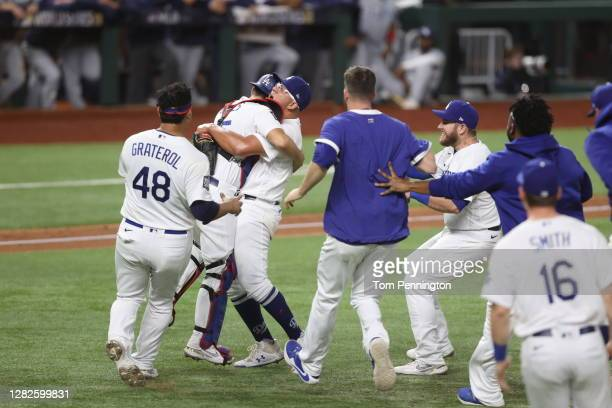 The Los Angeles Dodgers celebrate after defeating the Tampa Bay Rays in Game Six to win the 2020 MLB World Series at Globe Life Field on October 27,...