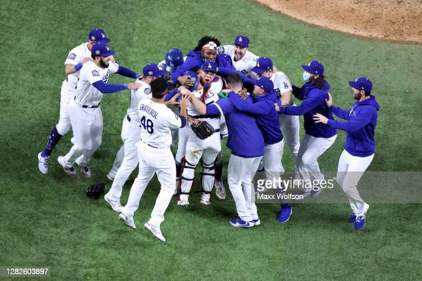 The Los Angeles Dodgers celebrate after defeating the Tampa Bay Rays 3-1 in Game Six to win the 2020 MLB World Series at Globe Life Field on October...