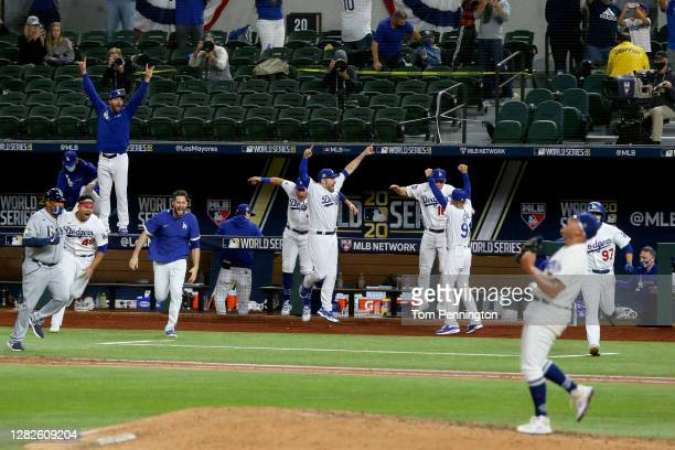 The Los Angeles Dodgers celebrate after Julio Urias strikes out Willy Adames of the Tampa Bay Rays to give the Dodgers the 3-1 victory in Game Six to...