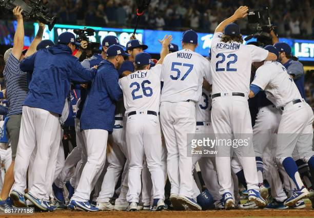 The Los Angeles Dodgers celebrate after Justin Turner hits the winning home run in the bottom of the ninth inning making the score 41 during Game Two...