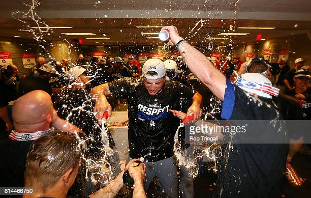 The Los Angeles Dodgers celebrate in the clubhouse after defeating the Washington Nationals 43 in Game 5 of NLDS at Nationals Park on Thursday...