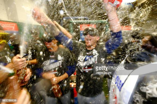 The Los Angeles Dodgers celebrate in the clubhouse after defeating the Chicago Cubs 111 in game five of the National League Championship Series at...