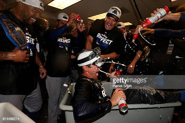 The Los Angeles Dodgers celebrate in the clubhouse after winning game five of the National League Division Series over the Washington Nationals 43 at...