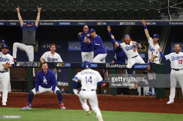 The Los Angeles Dodgers celebrate the solo home run by Enrique Hernandez against the Atlanta Braves during the sixth inning in Game Seven of the...