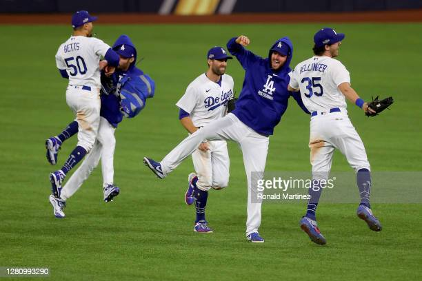 The Los Angeles Dodgers celebrate their 4-3 victory against the Atlanta Braves in Game Seven of the National League Championship Series at Globe Life...