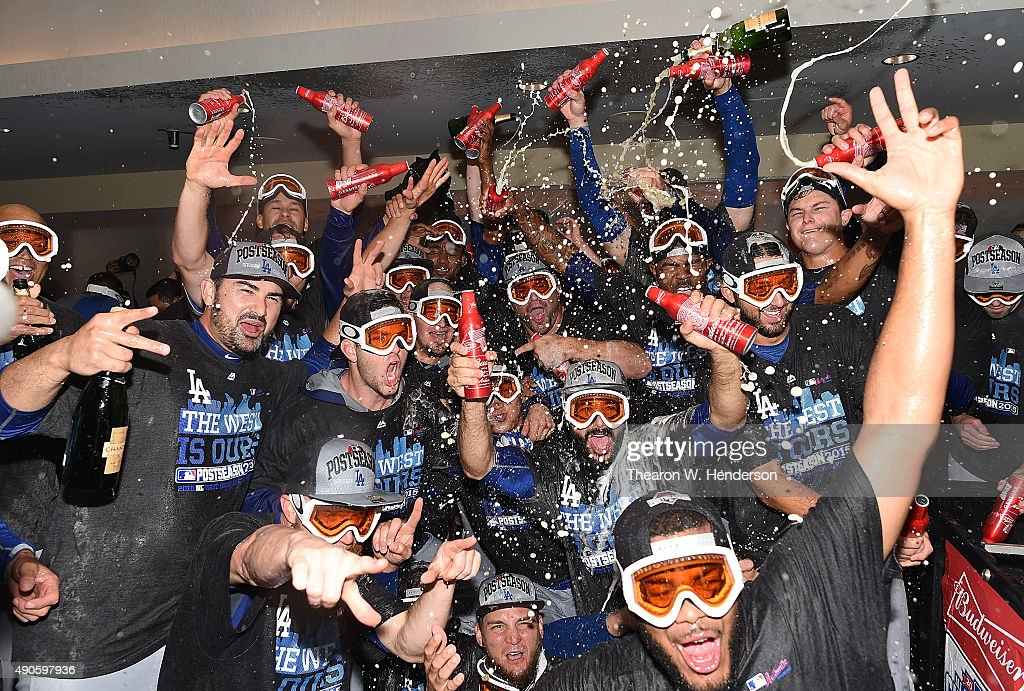 The Los Angeles Dodgers celebrates in the locker room with champagne and beer after they defeated the San Francisco Giants 8-0 to clinch the National League West at AT&T Park on September 29, 2015 in San Francisco, California.