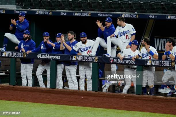 The Los Angeles Dodgers dugout celebrates during Game 6 of the 2020 World Series between the Los Angeles Dodgers and the Tampa Bay Rays at Globe Life...