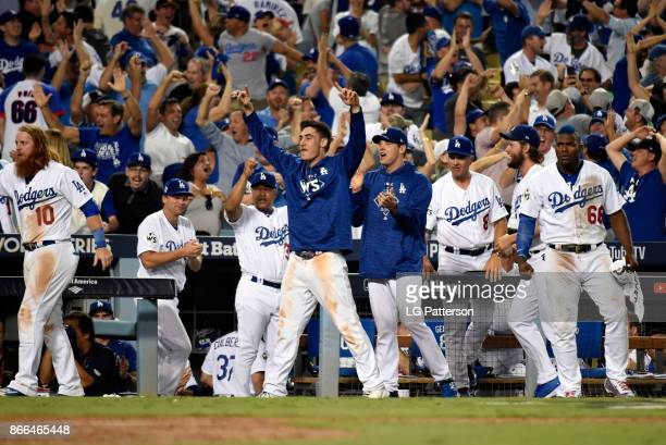 The Los Angeles Dodgers dugout celebrates in the 10th inning of Game 2 of the 2017 World Series against the Houston Astros at Dodger Stadium on...