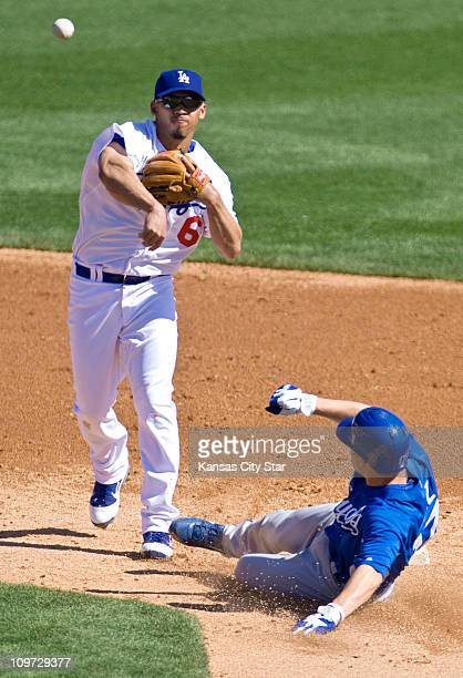 The Los Angeles Dodgers' Ivan DeJesus left forces out the Kansas City Royals' Chris Getz at second base and completes the double play on the Royals'...