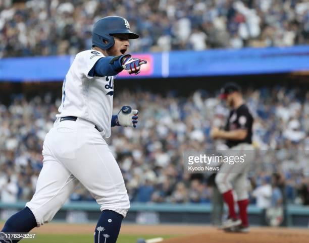 The Los Angeles Dodgers' Max Muncy circles the bases after hitting a tworun home run off Washington Nationals starter Stephen Strasburg in the first...