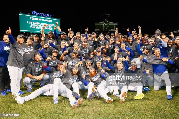 The Los Angeles Dodgers pose after defeating the Chicago Cubs 11-1 in game five of the National League Championship Series at Wrigley Field on...