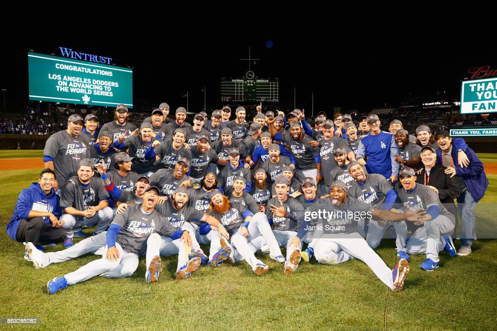 The Los Angeles Dodgers pose after defeating the Chicago Cubs 11-1 in game five of the National League Championship Series at Wrigley Field on October 19, 2017 in Chicago, Illinois. The Dodgers advance to the 2017 World Series.