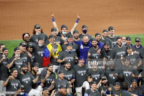 The Los Angeles Dodgers pose for a photo after defeating the Tampa Bay Rays 3-1 in Game Six to win the 2020 MLB World Series at Globe Life Field on...
