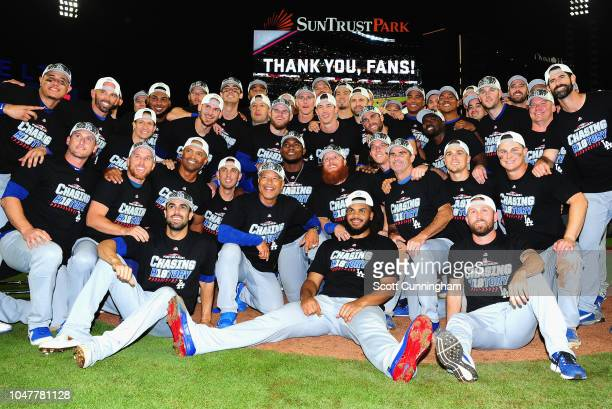 The Los Angeles Dodgers pose together on the field after winning Game Four of the National League Division Series with a score of 62 over the Atlanta...