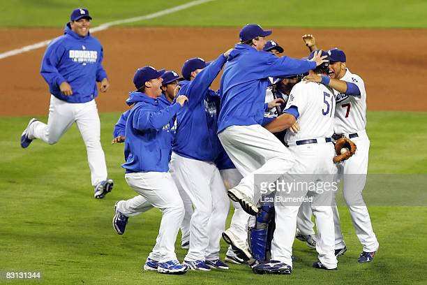 The Los Angeles Dodgers react as they defeat the Chicago Cubs in Game Three of the NLDS during the 2008 MLB playoffs on October 4 2008 at Dodger...