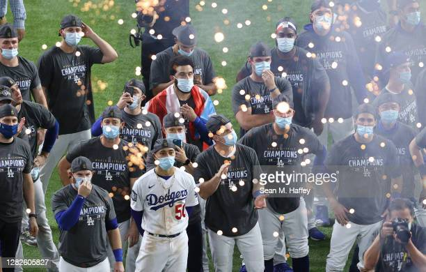 The Los Angeles Dodgers react during the Commissioner's Trophy presentation ceremony after defeating the Tampa Bay Rays 31 in Game Six to win the...