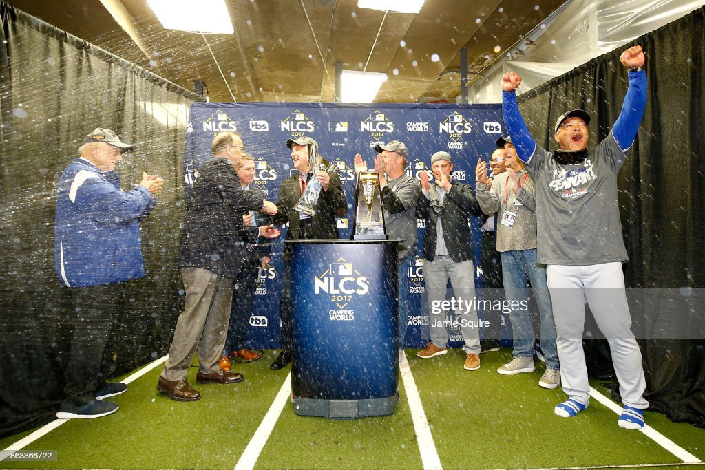 The Los Angeles Dodgers receive the Warren C. Giles Trophy in the clubhouse after defeating the Chicago Cubs 11-1 in game five of the National League Championship Series at Wrigley Field on October 19, 2017 in Chicago, Illinois. The Dodgers advance to the 2017 World Series.