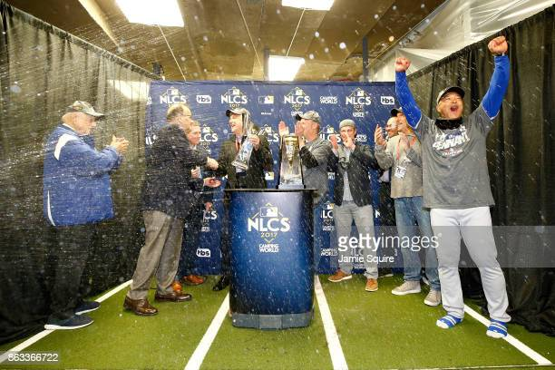 The Los Angeles Dodgers receive the Warren C. Giles Trophy in the clubhouse after defeating the Chicago Cubs 11-1 in game five of the National League...