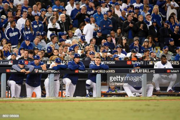 The Los Angeles Dodgers watch the action from the dugout during Game 7 of the 2017 World Series against the Houston Astros at Dodger Stadium on...