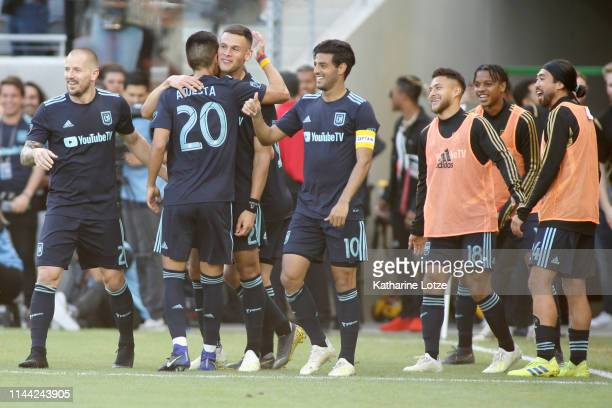 The Los Angeles FC celebrate a goal during a game against the Seattle Sounders at Banc of California Stadium on April 21 2019 in Los Angeles...