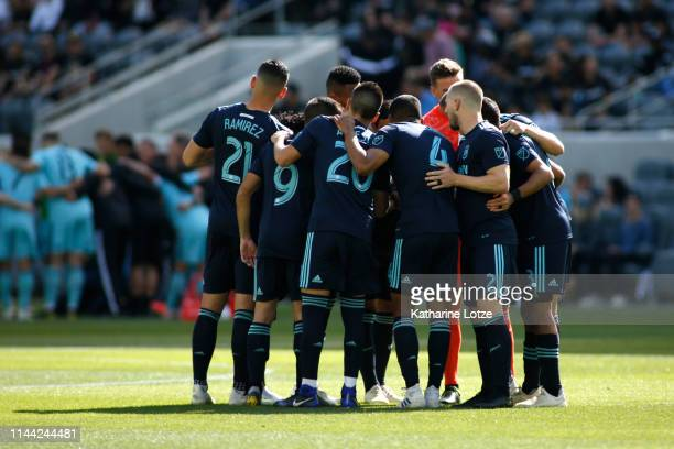 The Los Angeles FC huddle before the start of a game against the Seattle Sounders at Banc of California Stadium on April 21 2019 in Los Angeles...