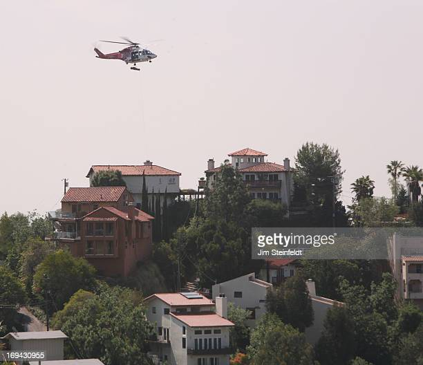 The Los Angeles Fire Department using a helicopter rescued a worker who had fallen from a scaffolding during hillside construction in the 8300 block...