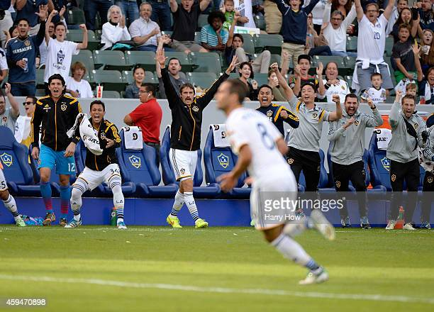 The Los Angeles Galaxy bench react to the goal of Marcelo Sarvas to take a 10 lead over the Seattle Sounders FC during the Western Conference Final...