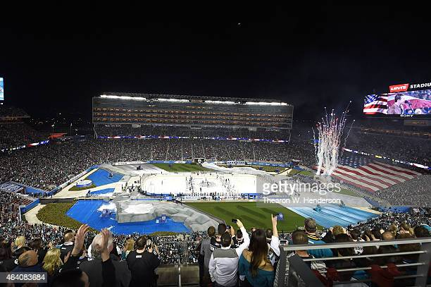The Los Angeles Kings and San Jose Sharks stand during the national anthem at Levi's Stadium on February 21 2015 in Santa Clara California
