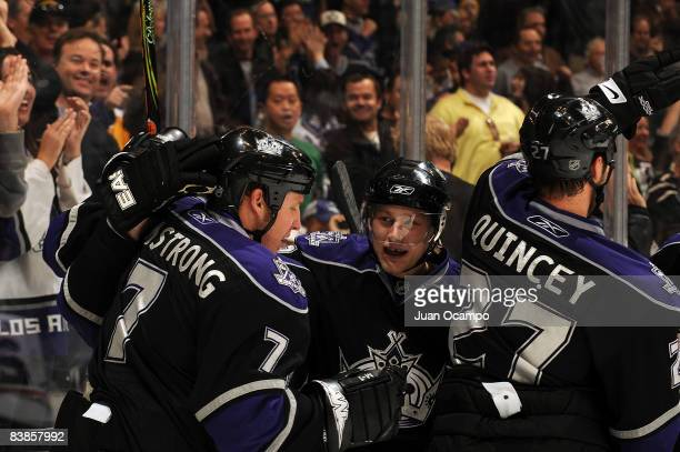 The Los Angeles Kings celebrate a third period goal from teammate Derek Armstrong during the game on November 29, 2008 at Staples Center in Los...