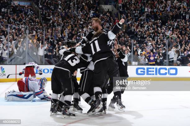 The Los Angeles Kings celebrate after defeating the New York Rangers in the second overtime period of Game Five of the 2014 NHL Stanley Cup Final at...