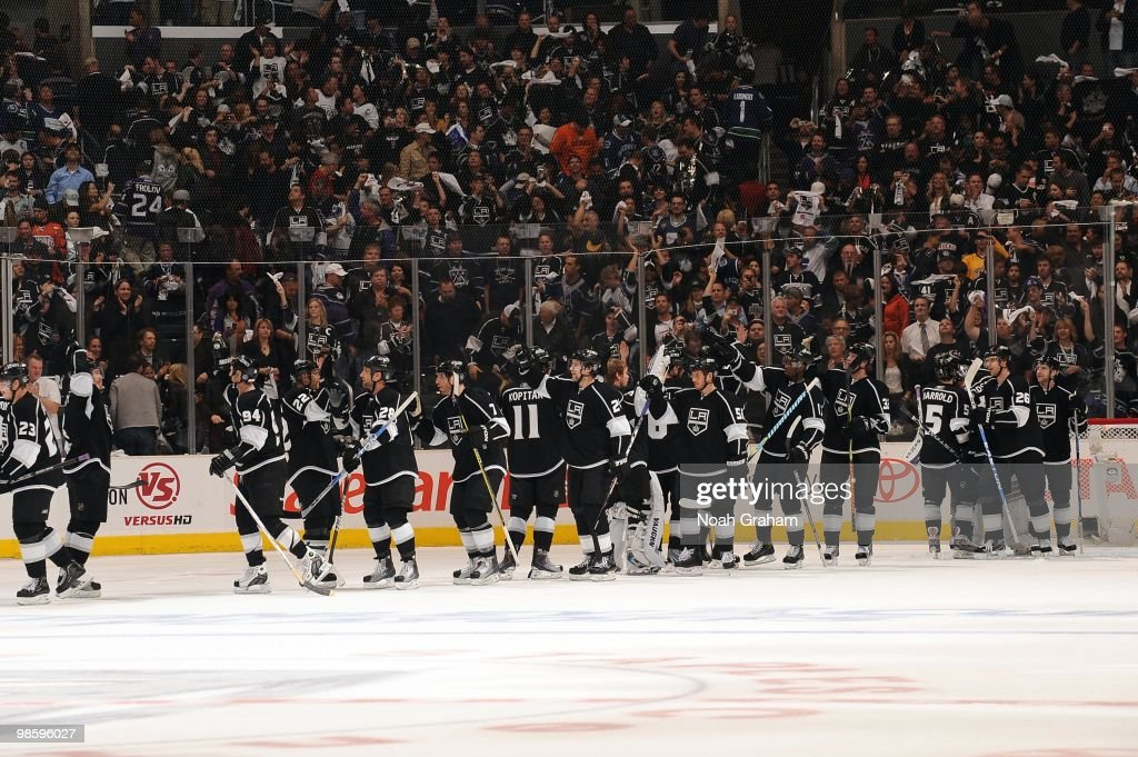 The Los Angeles Kings celebrate after defeating the Vancouver Canucks in Game Three of the Western Conference Quarterfinals during the 2010 NHL Stanley Cup Playoffs at Staples Center on April 19, 2010 in Los Angeles, California.