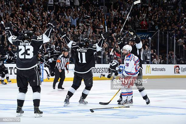 The Los Angeles Kings celebrate after scoring the game-winning goal in the second overtime period of Game Two of the Stanley Cup Final against the...