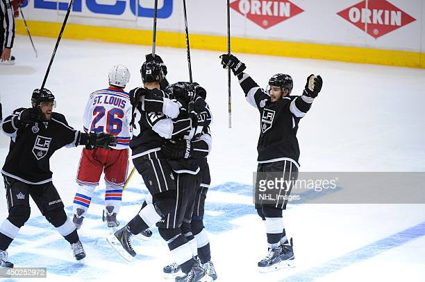 The Los Angeles Kings celebrate after scoring the game-winning goal against the New York Rangers in the second overtime period of Game Two of the...