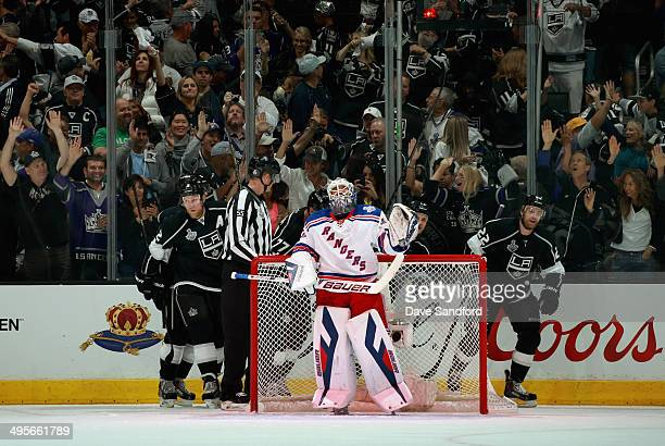 The Los Angeles Kings celebrate behind goaltender Henrik Lundqvist of the New York Rangers after Kyle Clifford scored during the first period of Game...