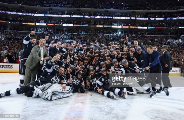 The Los Angeles Kings pose for a team shot with the Stanley Cup after the Kings defeated the New Jersey Devils 61 to win the Stanley Cup series 42 in...