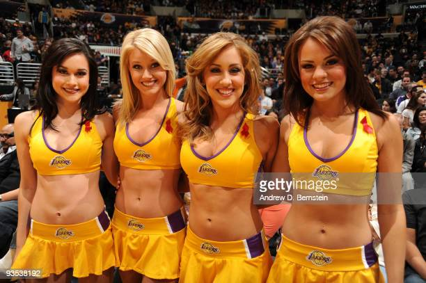 The Los Angeles Laker Girls wear red ribbons marking World AIDS Awareness Day before a game against the New Orleans Hornets at Staples Center on...
