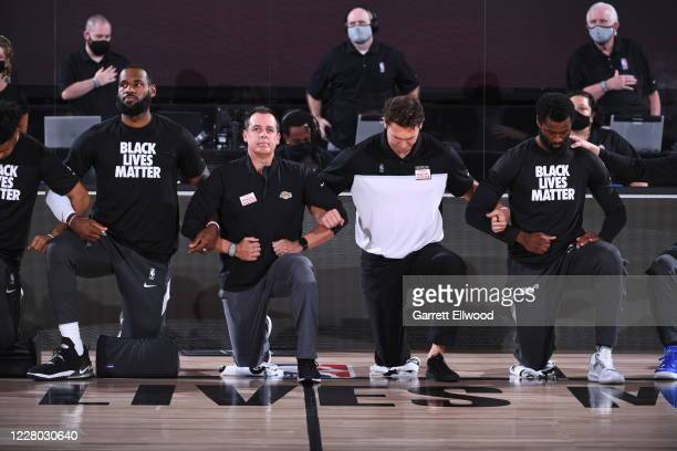 The Los Angeles Lakers and the Sacramento Kings kneels for the national anthem before the game on August 13 2020 at The Field House in Orlando...