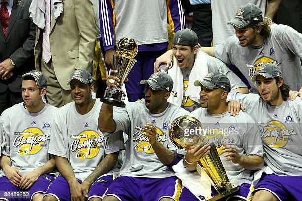 The Los Angeles Lakers celebrate after defeating the Orlando Magic 9986 in Game Five of the 2009 NBA Finals on June 14 2009 at Amway Arena in Orlando...