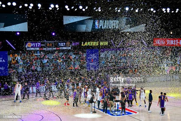 The Los Angeles Lakers celebrate after winning Game Five of the Western Conference Finals of the NBA Playoffs against the Denver Nuggets on September...