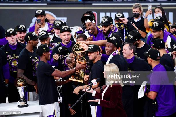 The Los Angeles Lakers celebrate with the trophy after winning the 2020 NBA Championship Final over the Miami Heat in Game Six of the 2020 NBA Finals...