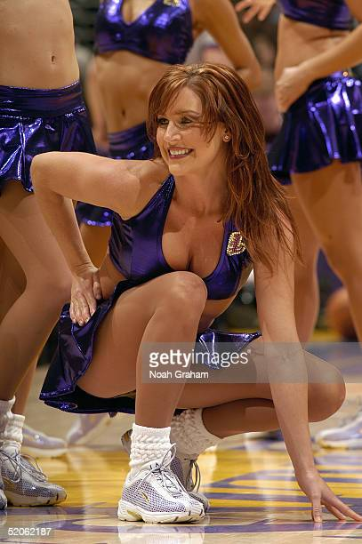 The Los Angeles Lakers dance team performs during the game with the Houston Rockets on January 7 2004 at the Staples Center in Los Angeles California...