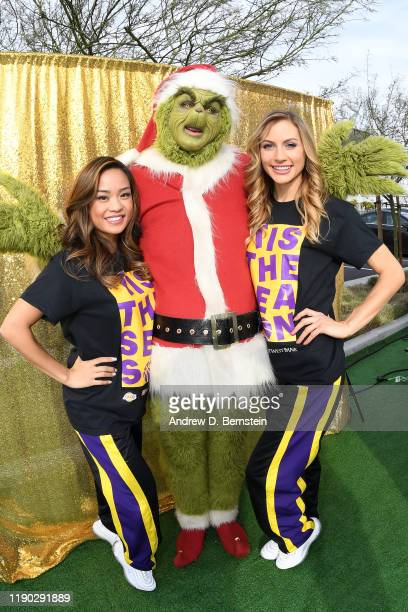The Los Angeles Lakers Girls pose for a photo with the Grinch during the Los Angeles Lakers Annual Holiday Party for Kids presented by East West Bank...