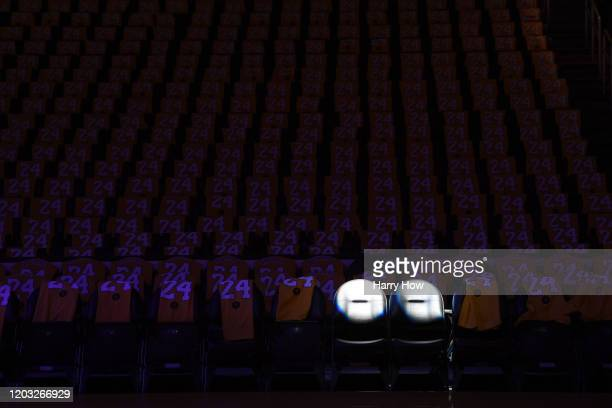 The Los Angeles Lakers honor Kobe Bryant and daughter Gigi by spotlighting empty courtside seats before the game against the Portland Trail Blazers...