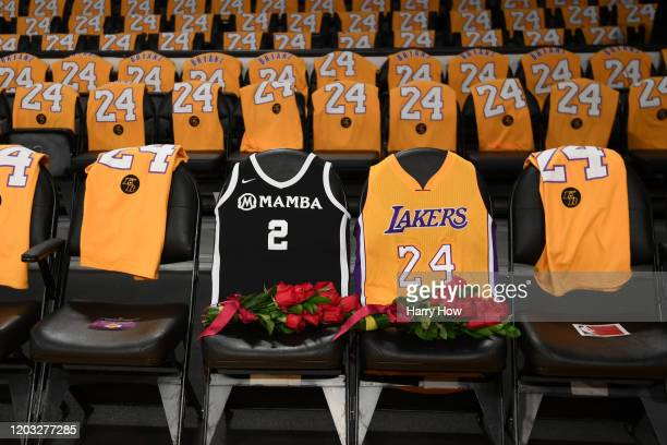 The Los Angeles Lakers honor Kobe Bryant and daughter Gigi by covering the courtside seats they occupied with flowers Gigi's Mamba jersey and Kobe's...