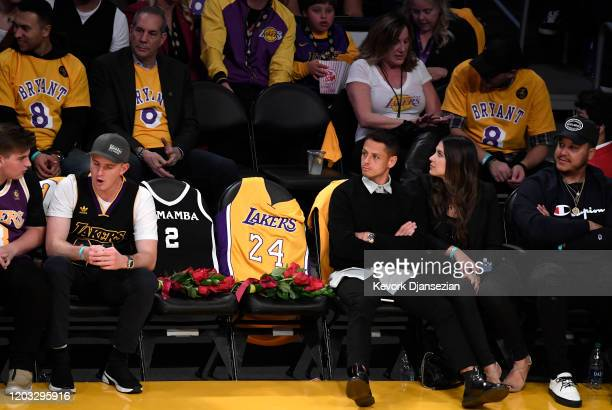 The Los Angeles Lakers honor Kobe Bryant and daughter Gigi by covering the courtside seats they occupied with flowers, Gigi's Mamba jersey and Kobe's...