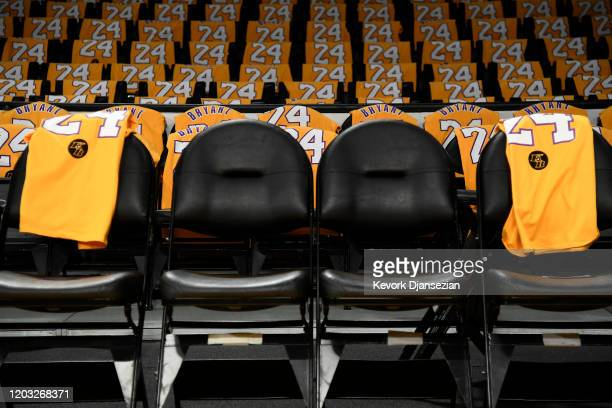 The Los Angeles Lakers honor Kobe Bryant and daughter Gigi by with empty courtside seats before the game against the Portland Trail Blazers at...