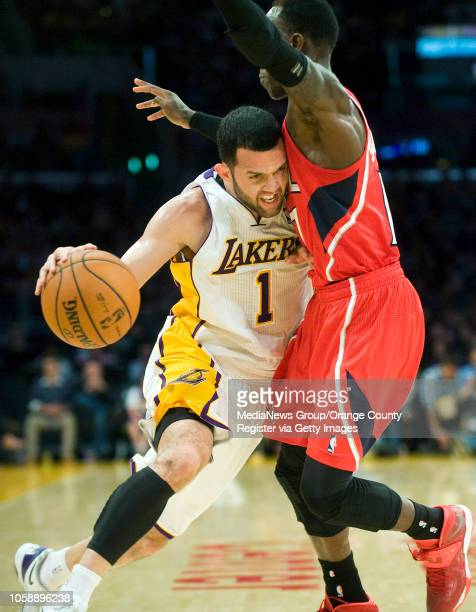 The Los Angeles Lakers' Jordan Farmar tries to get past the Atlanta Hawks' Dennis Schroder at Staples Center in Los Angeles CA on November 2 2013