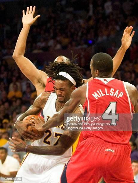 The Los Angeles Lakers' Jordan Hill tries to get through Atlanta Hawks' defenders at Staples Center in Los Angeles CA on November 2 2013